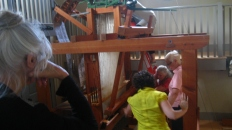 Samuel Lowry Jacquard Loom restoration team making adjustments